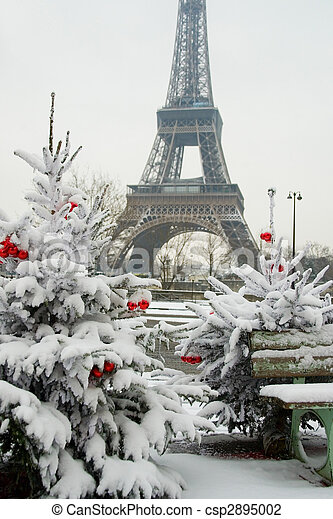 rare snowy day in paris the eiffel tower and decorated christmas tree csp2895002