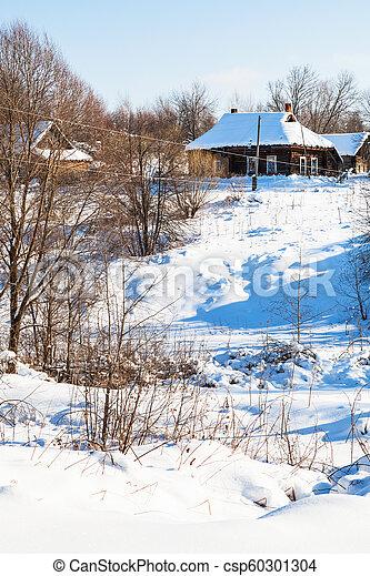 ravine and little russian village in winter - csp60301304