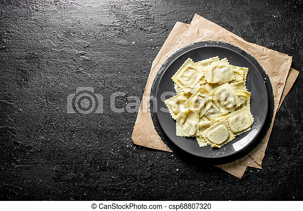 Ravioli with meat on a plate. - csp68807320
