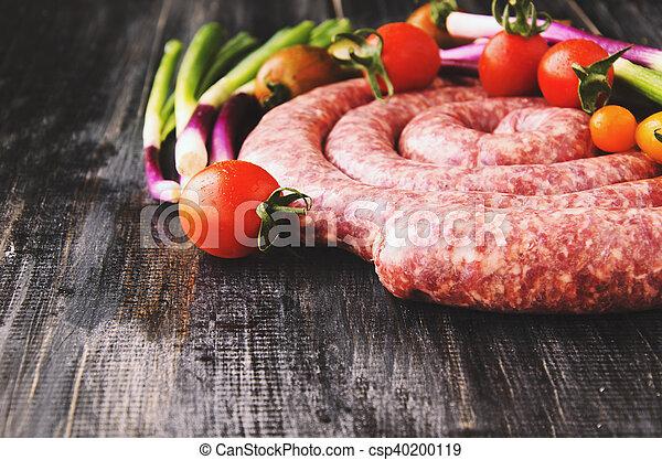 raw beef sausages, selective focus - csp40200119