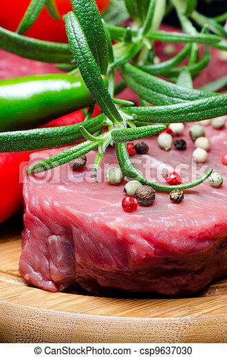 Raw beef steak on wooden board - csp9637030