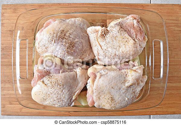 Raw chicken thighs - csp58875116