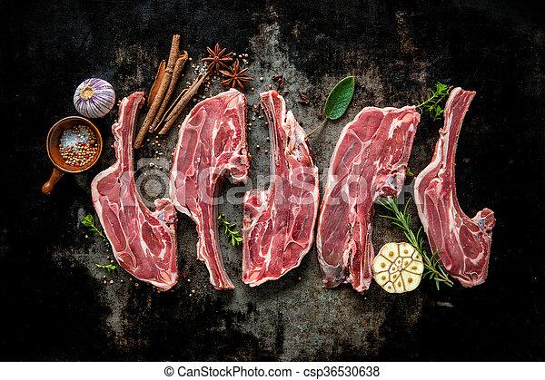 Raw fresh lamb meat on dark background - csp36530638