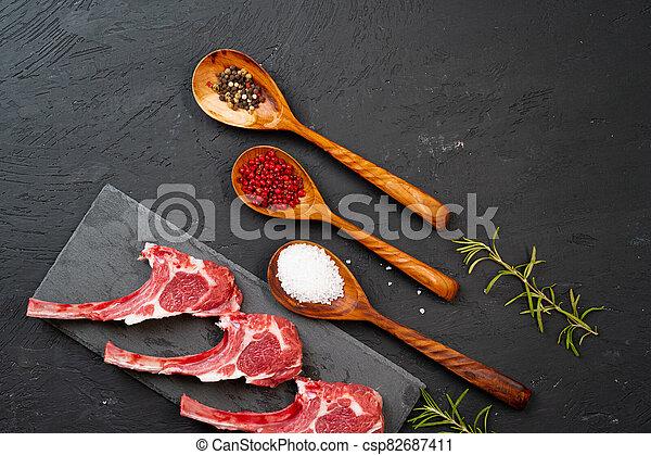 Raw fresh lamb ribs on dark background - csp82687411