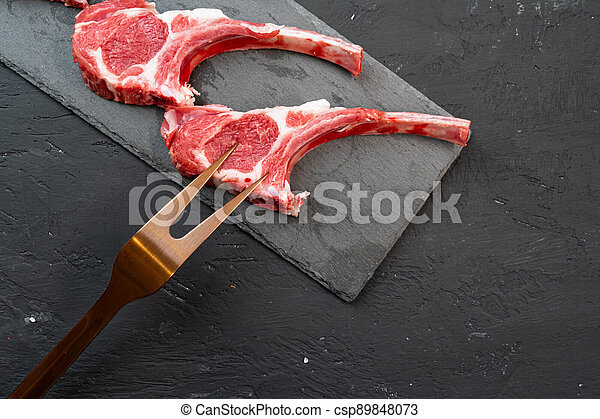 Raw fresh lamb ribs on dark background - csp89848073