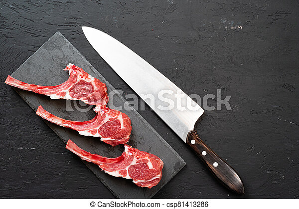 Raw fresh lamb ribs on dark background - csp81413286