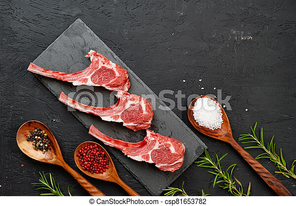 Raw fresh lamb ribs on dark background - csp81653782