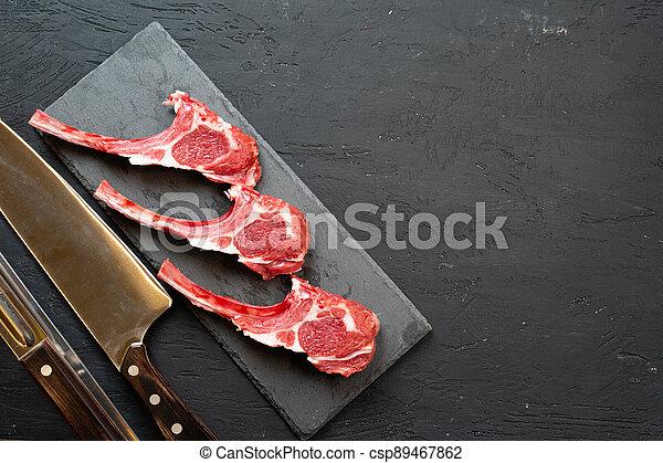 Raw fresh lamb ribs on dark background - csp89467862
