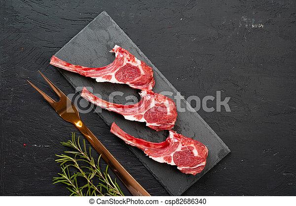 Raw fresh lamb ribs on dark background - csp82686340