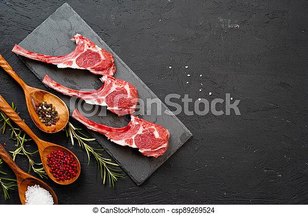 Raw fresh lamb ribs on dark background - csp89269524