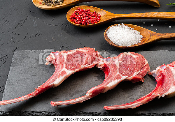 Raw fresh lamb ribs on dark background - csp89285398