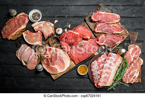 Raw meat. Different kinds of pork and beef meat. - csp67024161