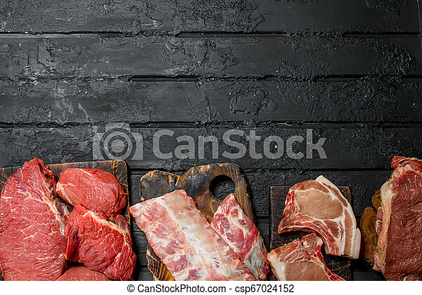 Raw meat. Different kinds of pork and beef meat. - csp67024152