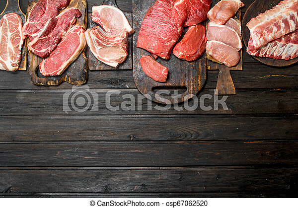 Raw meat. Different kinds of pork and beef meat. - csp67062520
