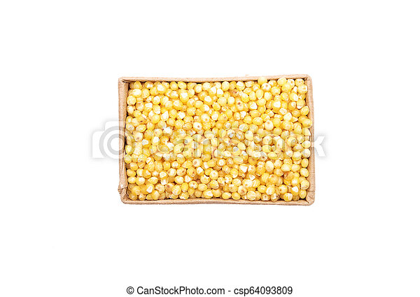 Raw millet in carton and on white background - csp64093809
