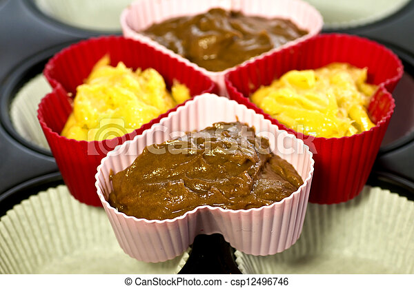 raw muffins in a heart form - csp12496746