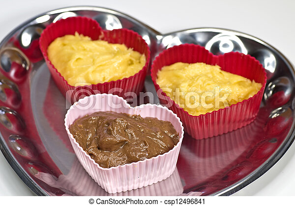 raw muffins in a heart form - csp12496841