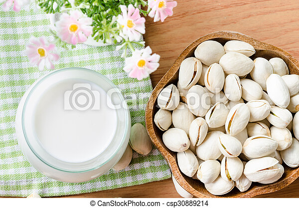 Raw Organic Pistachio Nuts in a Bowl - csp30889214