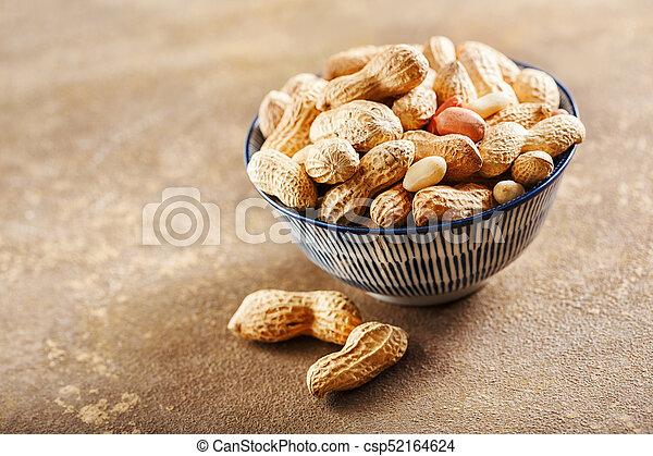 Raw peanuts in bowl - csp52164624