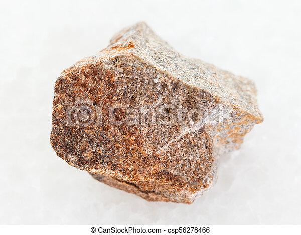 Raw Quartzite Stone On White Marble