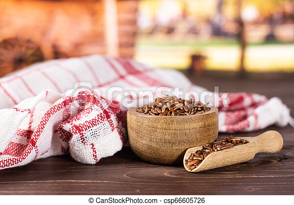 Raw red rice with cart - csp66605726