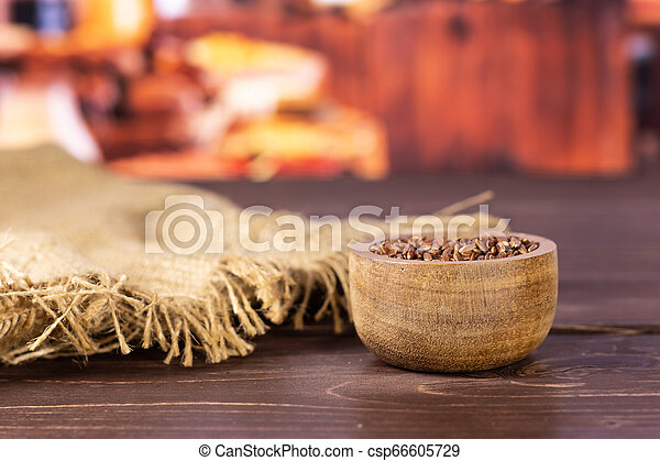 Raw red rice with rustic kitchen - csp66605729