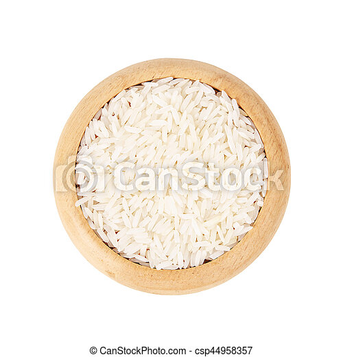 Raw white rice in wooden dish. - csp44958357