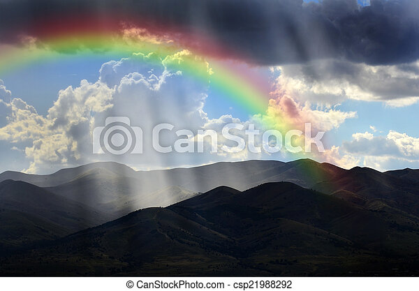 Rays of Sunlight on Peaceful Mountains and Rainbow - csp21988292