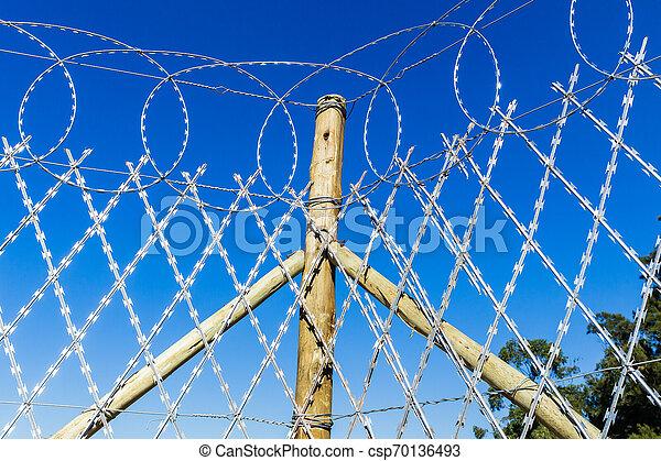 Razor Wire Fence - csp70136493
