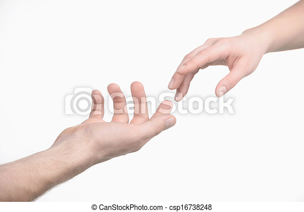 Reaching a hand. Close-up of human hands trying to reach each other - csp16738248