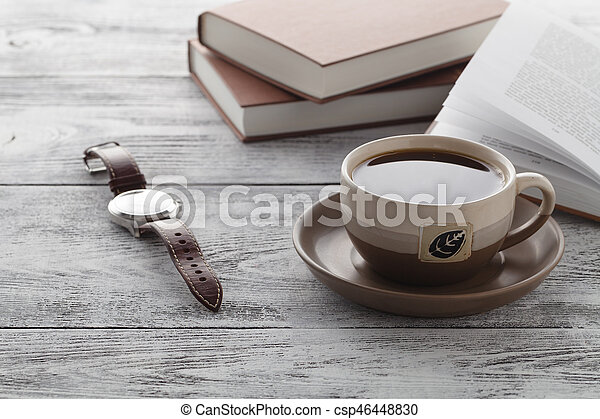Reading book in time of breakfast with coffee - csp46448830