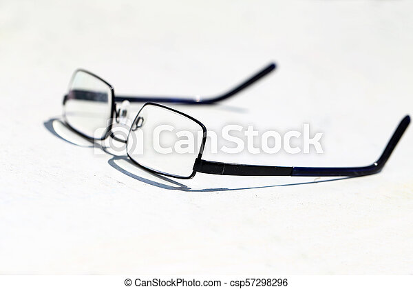 Reading glasses on the table - csp57298296