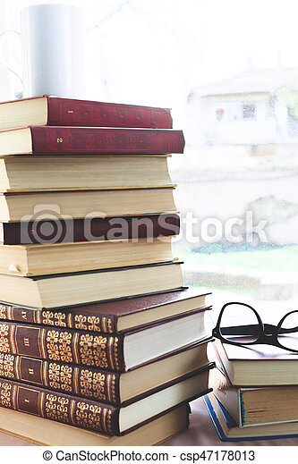 reading glasses with books on the table - csp47178013