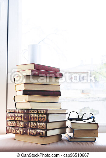 reading glasses with books on the table - csp36510667
