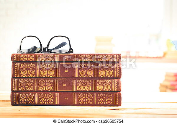 reading glasses with books on the table - csp36505754