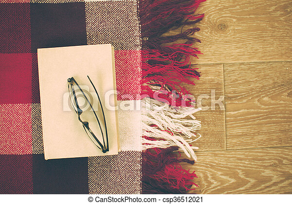reading glasses with books on the table - csp36512021