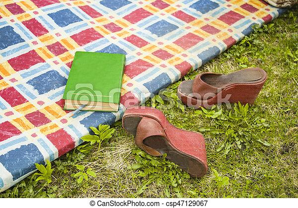 Reading In A Garden - csp47129067