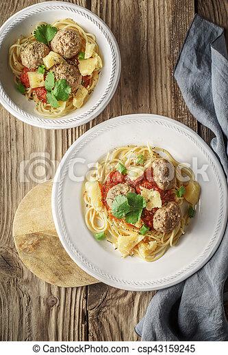 Ready-made spaghetti. meatballs and napkin at the board - csp43159245
