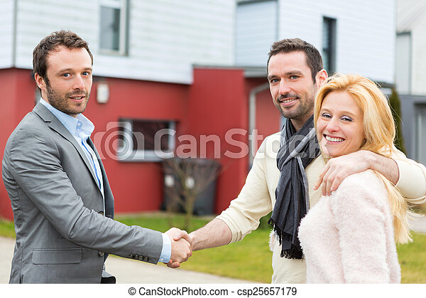 Real estate agent delivers keys to  - csp25657179