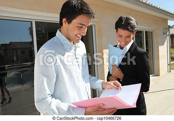 Real estate agent with her client - csp10466726