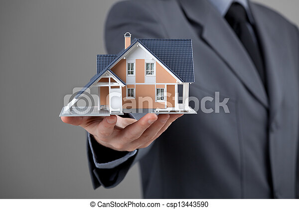 Real estate agent with house - csp13443590