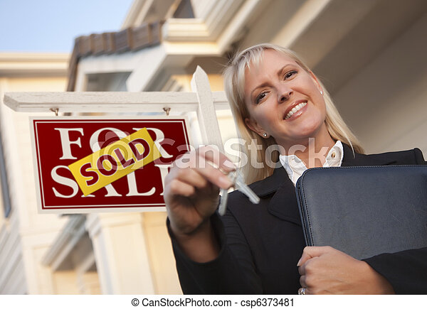 Real Estate Agent with Keys in Front of Sold Sign and House - csp6373481