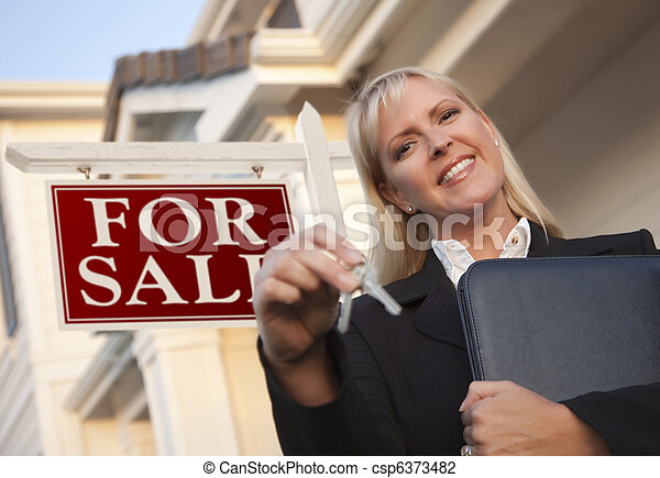 Real Estate Agent with Keys in Front of Sign and House - csp6373482
