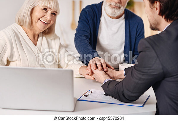 Real estate agent working with elderly couple of customers - csp45570284