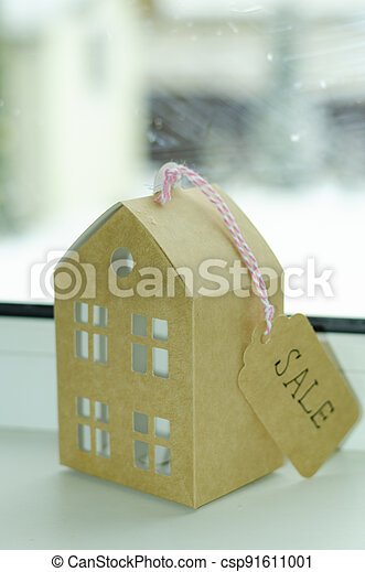 Real estate sale concept, paper model of residential building. - csp91611001