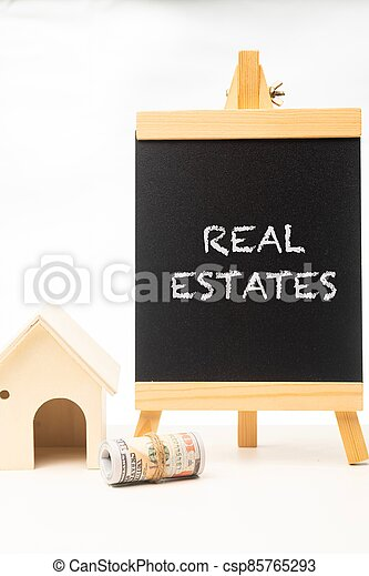 Real Estates wordings on a chalkboard - csp85765293