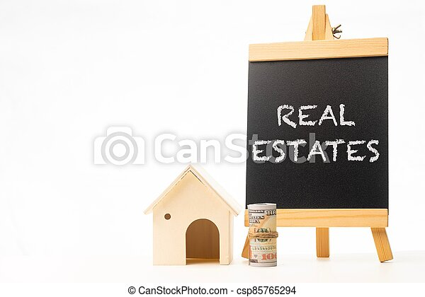 Real Estates wordings on a chalkboard - csp85765294