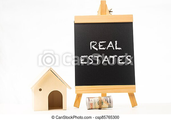 Real Estates wordings on a chalkboard - csp85765300