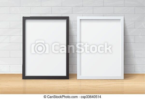 Realistic White And Black Blank Picture Frame Standing On Light Wood Floor At