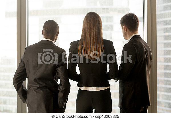 Rear view at african and caucasian businesspeople standing near - csp48203325